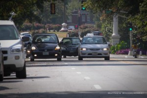 In heavy traffic cars will sometimes drive on the right.  Such aggressive driving is intimidating and dangerous, particularly near parked cars.