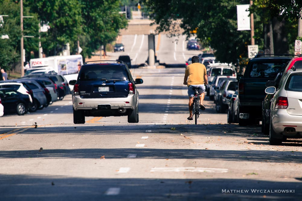 A dedicated bike lane would preserve the current arrangement even in heavy traffic, restricting driving to the left lane and protecting cyclists' space on the right.