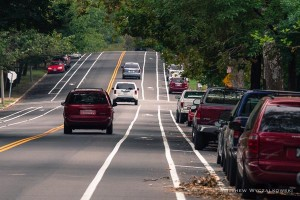 A view of the new bike lanes along Arsenal looking east.  The stretch of road between Roger and Grand has been restriped to provide a 7' parking lane, a 3' buffer, a 5' bike lane, and a 10' travel lane.